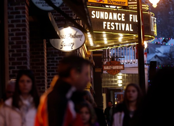 People walk past the Egyptian Theatre along Main Street before the opening day of the Sundance Film Festival in Park City