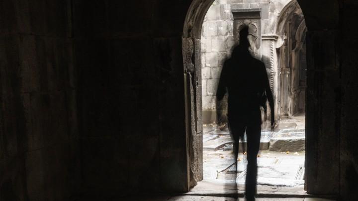Ghostly figure leaving the interior of Sanahin Monastery, Debed Canyon, Armenia